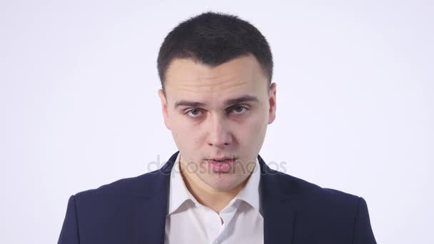 4K Close up face of evil man looking at the camera. Angry young man