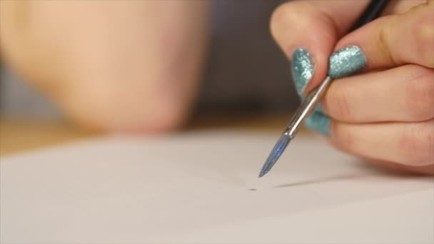 Artist painting with paintbrush close-up