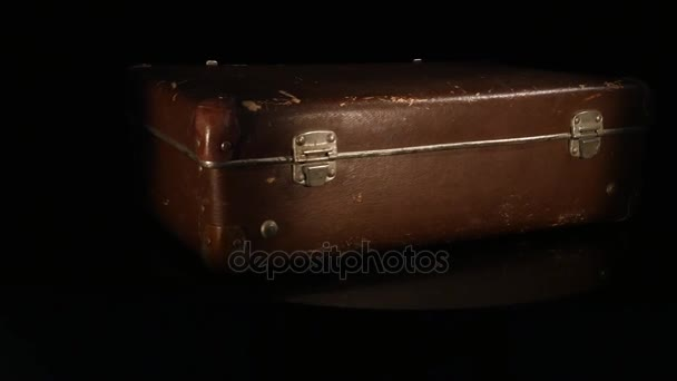 Old, retro suitcase rotate isolated on a white background
