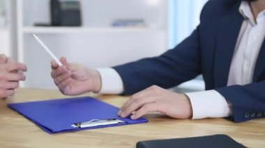 Handshake between two colleagues after signing a contract