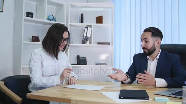 Real estate agent signing contract and giving keys to female client