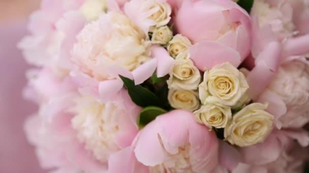 Beautiful fresh soft wedding decorative round shape bouquet of white rose and pink peony