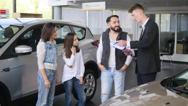 young man signed a contract of buying family car