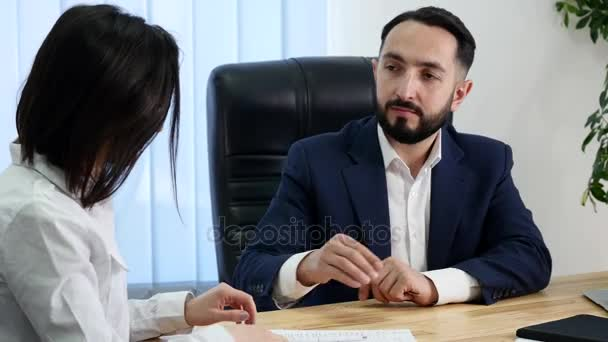 Businesswoman signs a contract and shakes hands on the deal