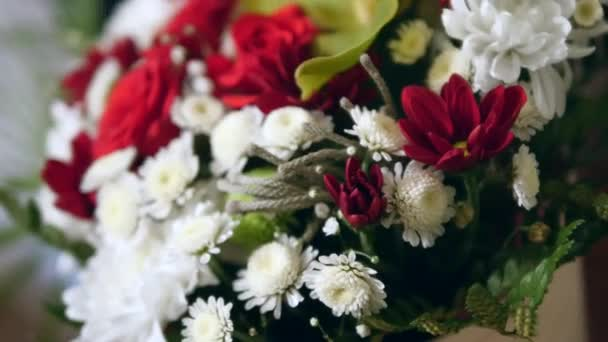 Beautiful wedding bouquet of red roses and white chrysanthemums