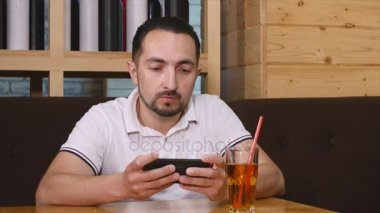 Man sit and use smartphone in the cafe