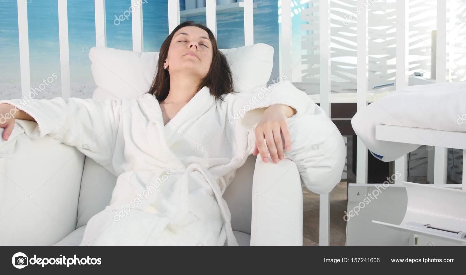 Beautiful woman relaxing in a bathrobe in spa salon — Stock Photo ... b448b7962