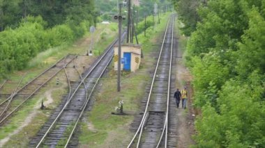 Two young people go on railway track