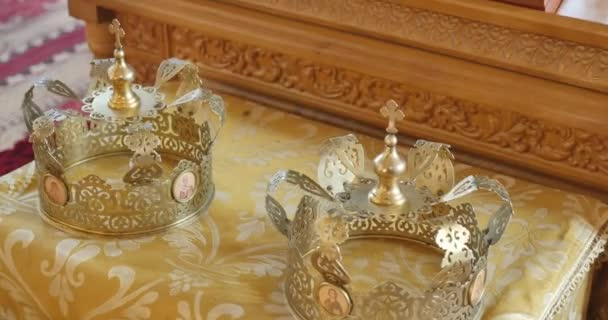 gold wedding crowns of marriage in a church, move camera close up