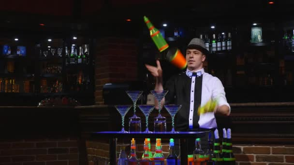 Acrobatic show performed by barman juggling two bottles and Beaker for mixing. bar background