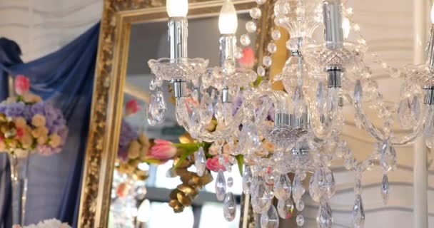 Luxury crystals of a classic chandelier.Close up beautiful crystals of a luxury chandelier. mirror background