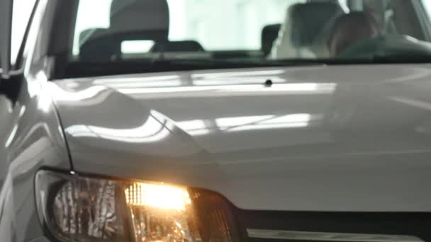 Car headlights flashing of white car