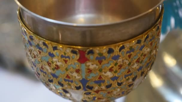 Church attributes for the wedding ceremony. Gold crowns are on the altar. Attributes of priest