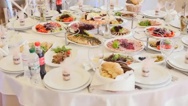 Table full of food. Served tables in restaurant