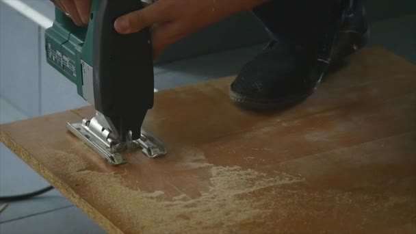 Close Up Of Carpenter Cutting A Wooden Plank A Man Cuts A Piece Of