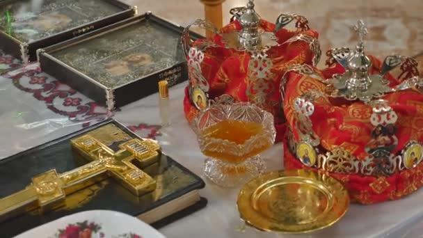 Church attributes for the wedding ceremony. Gold crowns are on the altar. Attributes of priest. Interior of church
