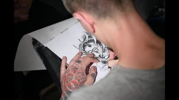 4d13af8d94a67 Tattoo artist drawing illustration inside ink studio. Man with dreadlocks  at work. New fashion lifestyle artistic trends concept . Warm cinematic  vintage ...