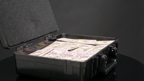 Close up rotation of case full of one million dollars