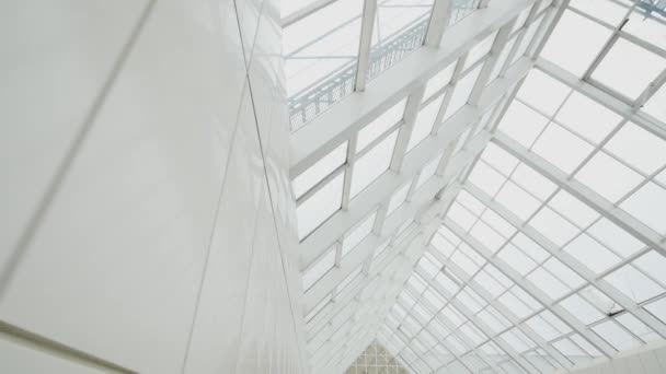 Transparent roof and sky. Glass panels and sunlight. Building of new business center