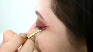 Artist drawing arrows. Close up. slow motion