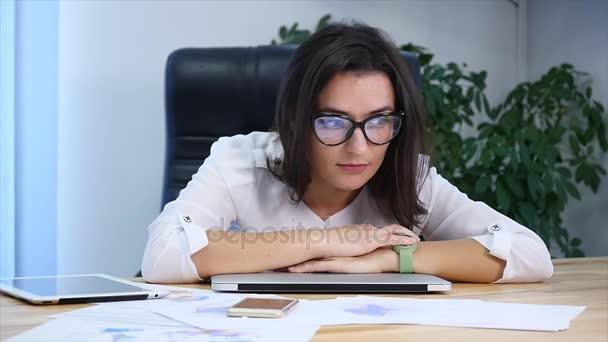 Tired businesswoman sleeping on the desk