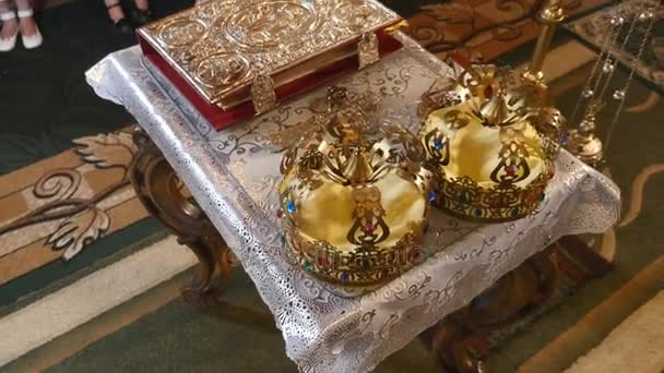 Church attributes for wedding ceremony. Gold crowns are on the altar. Attributes of priest. Interior of church