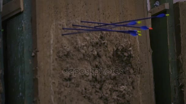 Arrow flying towards dart board and hitting target on grey background
