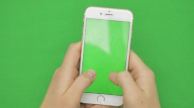 Using smart phone on green screen with various hand gestures, vertikal, close up - green screen
