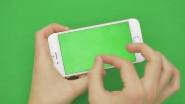 Using smart phone on green screen with various hand gestures, horizontally , close up - green screen