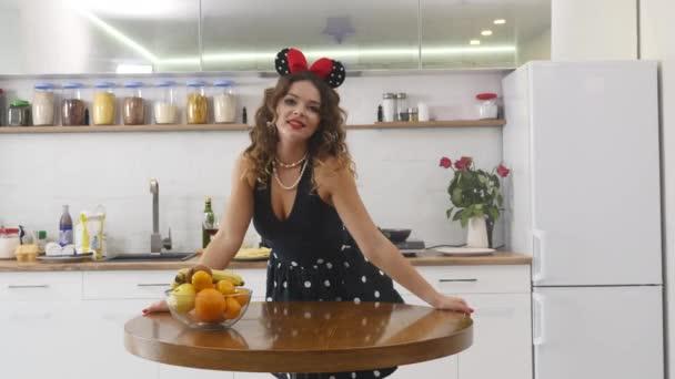 Beautiful happy joyful pinup style housewife in kitchen