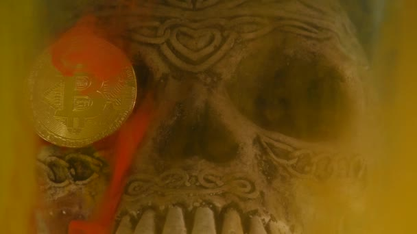 Skull in an aquarium and coin bitcoin with yellow and red ink