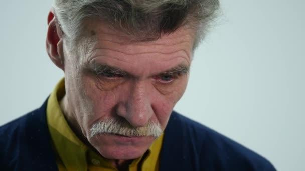 Sad senior man isolated on white background.Close up studio portrait