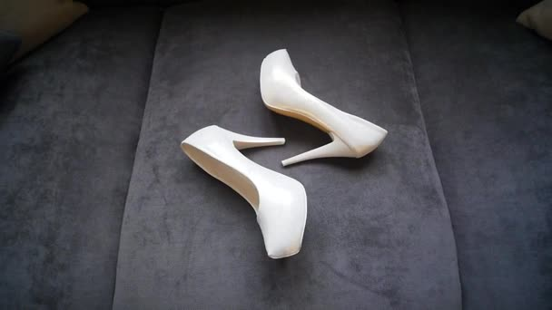 Brides wedding shoes on the sofa