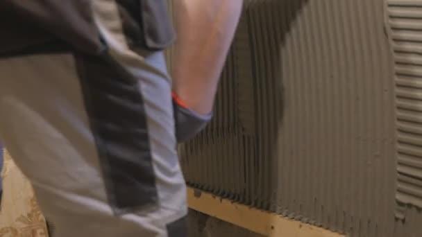 Detail pracovního zpomalené zdi-omítky - omítky stěrka