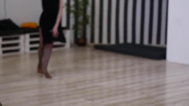 dancer woman excersizing in dance studio room. selective focus