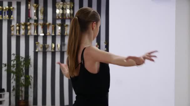 dancer woman excersizing in dance studio room