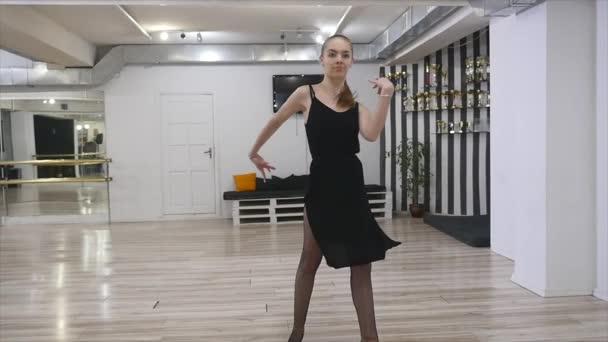 dancer woman excersizing in dance studio room.