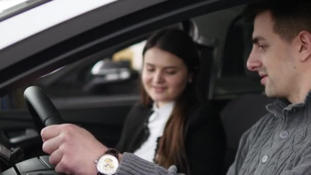 Buyer having conversation with car seller during inspecting the car
