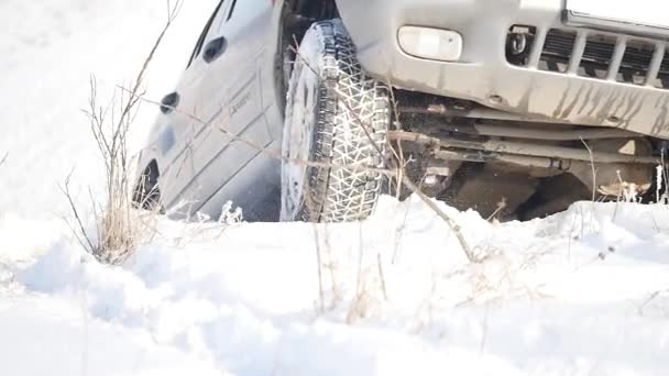 21.01.2018, Chernivtsi, Ukraine - DRIVING IN THE SNOW. Winter car tracks on snowy beach. Driving a race car on a snowy road. Track Winter car racing with sun reflection. Race on the track in the