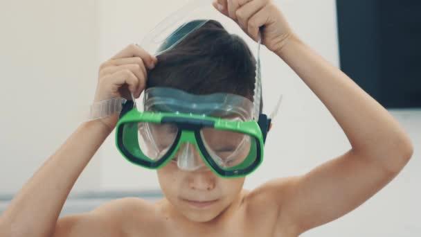 Little boy is wearing goggles. Copy space. 4K.