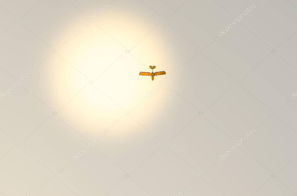 small plane flying in the sky