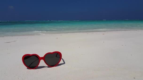 v02025 Maldives beautiful beach background white sandy tropical paradise island with blue sky sea water ocean 4k sunglasses