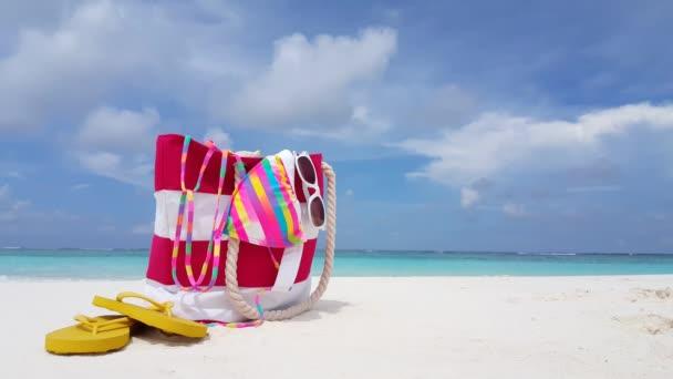 v02391 Maldives beautiful beach background white sandy tropical paradise island with blue sky sea water ocean 4k bag bikini flip flops