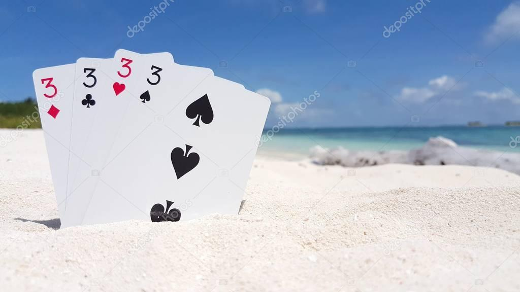 v01197 Maldives beautiful beach background white sandy tropical paradise island with blue sky sea water ocean 4k playing cards threes