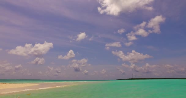 v00125 Maldives beautiful beach background white sandy tropical paradise island with blue sky sea water ocean 4k
