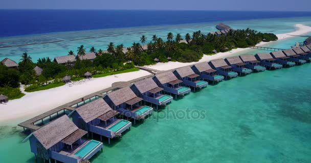v03692 Aerial flying drone view of Maldives white sandy beach on sunny tropical paradise island with aqua blue sky sea water ocean 4k luxury 5 star resort hotel water bungalow hut relaxing holiday