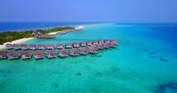 v03726 Aerial flying drone view of Maldives white sandy beach on sunny tropical paradise island with aqua blue sky sea water ocean 4k luxury 5 star resort hotel water bungalow hut relaxing holiday
