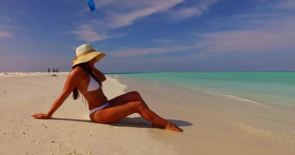 v07840 Maldives white sandy beach 1 person young beautiful lady sunbathing alone on sandbar on sunny tropical paradise island with aqua blue sky sea water ocean 4k