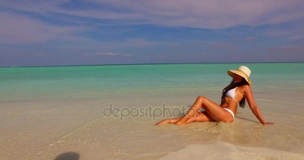 v07862 Maldives white sandy beach 1 person young beautiful lady sunbathing alone on sandbar on sunny tropical paradise island with aqua blue sky sea water ocean 4k