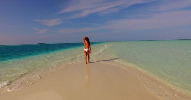 v07912 Maldives white sandy beach 1 person young beautiful lady sunbathing alone on sandbar on sunny tropical paradise island with aqua blue sky sea water ocean 4k